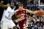 MEMPHIS, TN - MARCH 29:  Austin Johnson #20 of the Oklahoma Sooners drives on Ty Lawson #5 of the North Carolina Tar Heels in the first half during the NCAA Men's Basketball Tournament South Regional Final at the FedExForum on March 29, 2009 in Memphis, Tennessee.  (Photo by Joe Murphy/Getty Images)