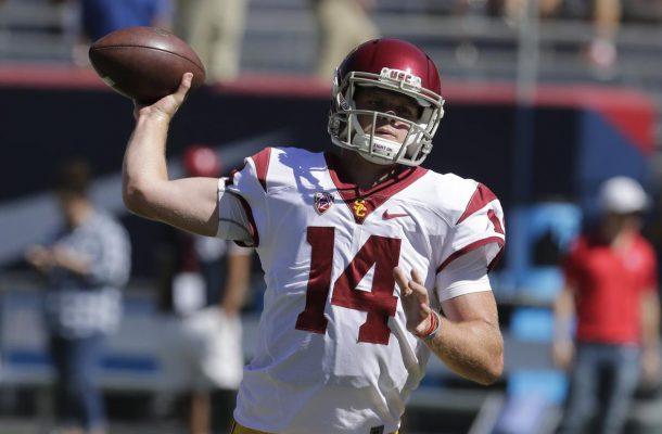 Southern California quarterback Sam Darnold warms up before an NCAA college football game against Arizona, Saturday, Oct. 15, 2016, in Tucson, Ariz. (AP Photo/Rick Scuteri)